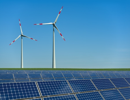 monocrystalline: Wind turbines and solar panels in a field