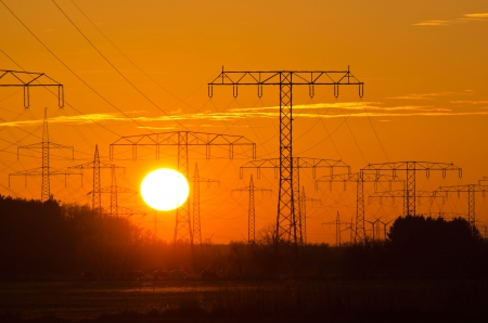 Sunset behind a power line photo