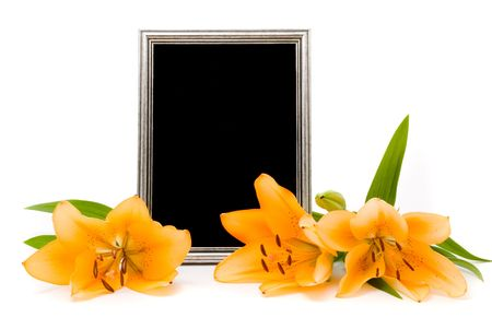 Yellow lilies and silver frame on a white background Stock Photo - 7395195