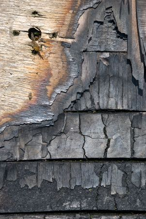 scorched: The scorched wooden background.