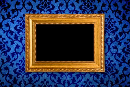 Gold frame on a vintage blue wall background  photo