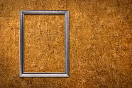 Silver frame on a yellow wall background photo