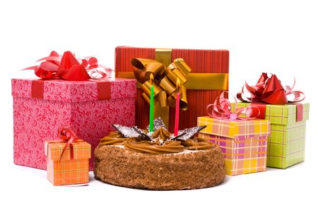 Pie with two candles and gifts in boxes on a white background photo