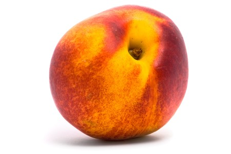 Juicy nectarine on a white background photo