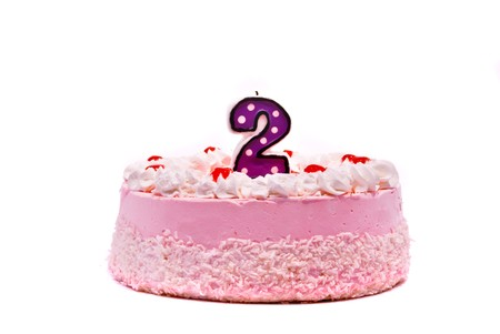 Pink cake with candle isolated on white background Stock Photo - 7477735