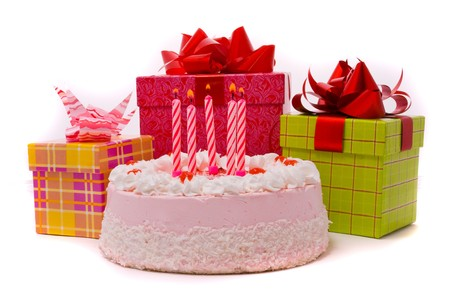 five year: Pink pie with five candles and gifts in boxes on a white background