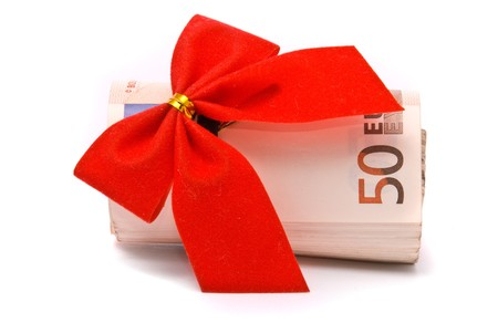 fifty euro banknote: Roll of Euro money and red bow isolated on white background