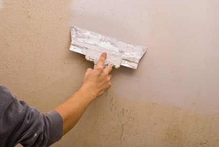Filling walls. House repair. Stock Photo - 7478885