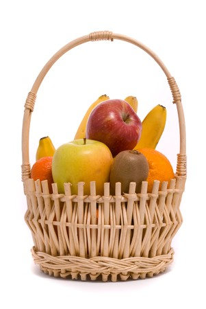 Basket with colorful fruits on a white background photo