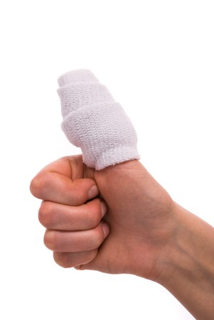 White medicine bandage on human injury hand finger photo