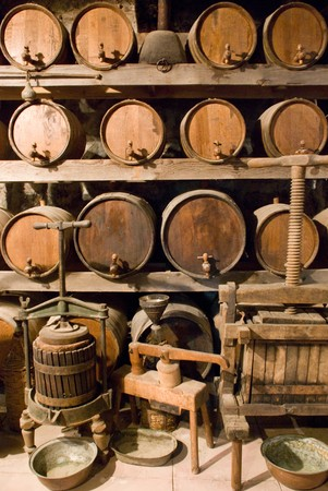 Wine barrels stacked in the old cellar of the vinery photo