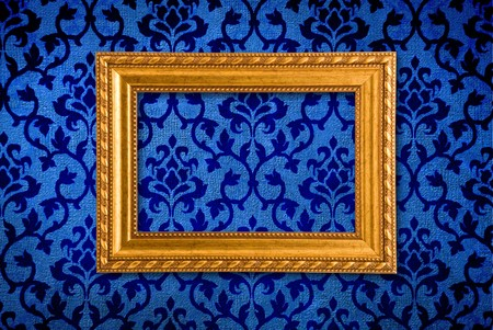 Gold frame on a vintage blue wall background