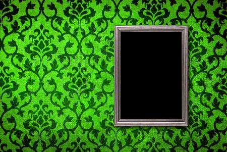 Silver frame on a vintage green wall background photo