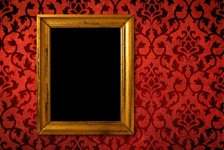 creative pictures: Gold frame on a vintage red wall background