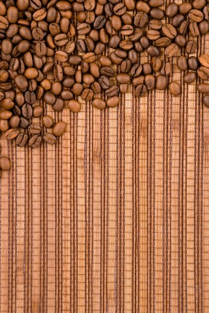 Coffee beans on the wooden background Stock Photo - 7503628