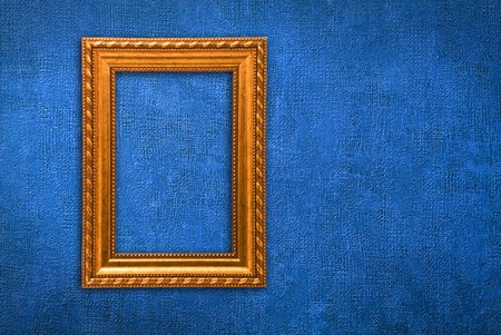 Gold frame on a old blue wall background