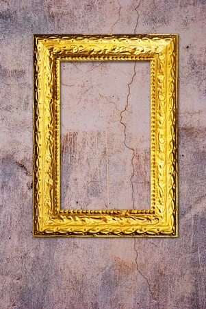 Gold frame on a old wall background