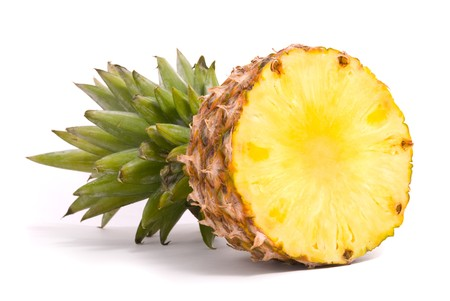 and pineapple juice: Sliced Pineapple on a white background