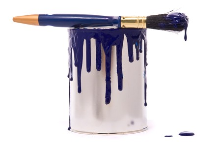 Can of blue paint and professional brush on a white photo