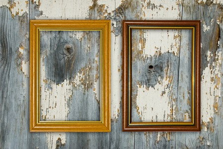 Gold frame on a old wooden wall background. Stock Photo
