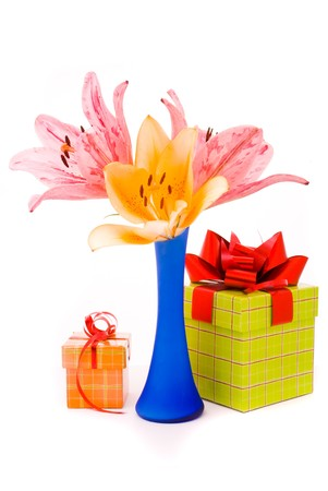 Beautiful lilies and gift box on a white background photo
