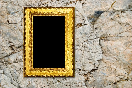 Gold frame on a stone background photo