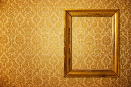 burnt wood: Vintage frame over golden wallpaper