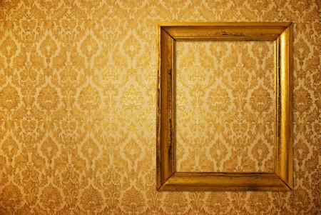 antiek behang: Vintage frame over gouden wall paper