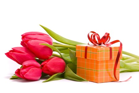 Red tulips and gift box on a white background photo