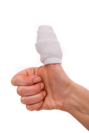 White medicine bandage on human injury hand finger. Studio isolated. Stock Photo