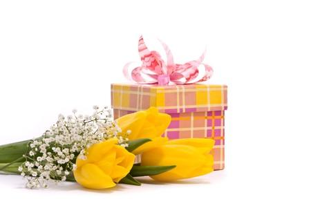 Yellow tulips and gift box on a white background photo