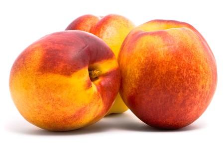 Juicy nectarines on a white background photo