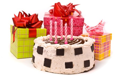 Pie with five candles and gifts in boxes on a white background Stock Photo