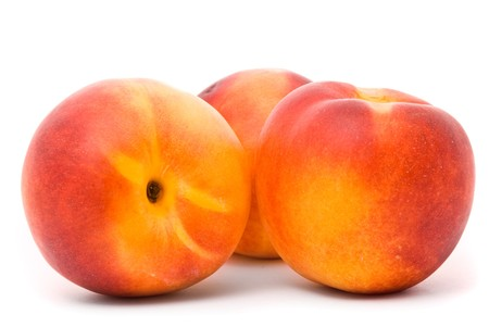 Juicy nectarines on a white background Stock Photo