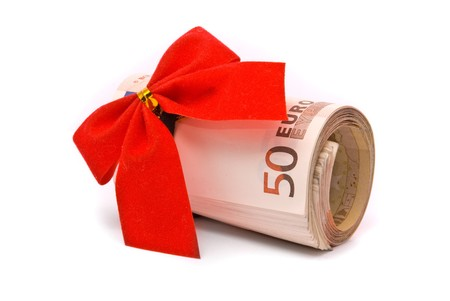 Roll of Euro money and red bow isolated on white background photo