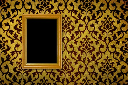 baroque room: Gold frame on a vintage yellow wall background  Stock Photo