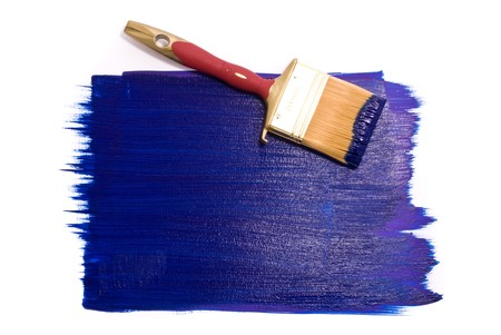 Brush with blue paint on the white background photo