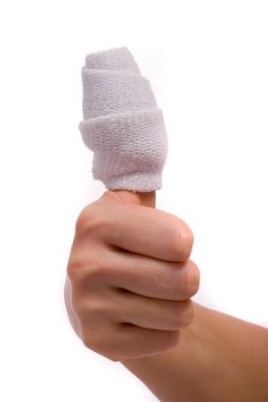White medicine bandage on human injury hand. Studio isolated. photo
