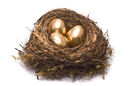 gold egg: Gold eggs in a nest Stock Photo