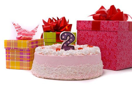 Pink pie with candle and gifts in boxes on a white background Stock Photo - 7849450