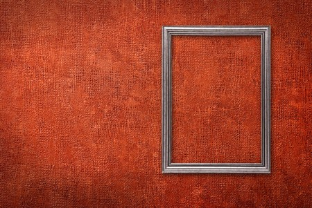 Silver frame on a red wall background photo