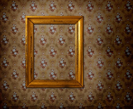 Golden frame over old grunge wallpaper photo