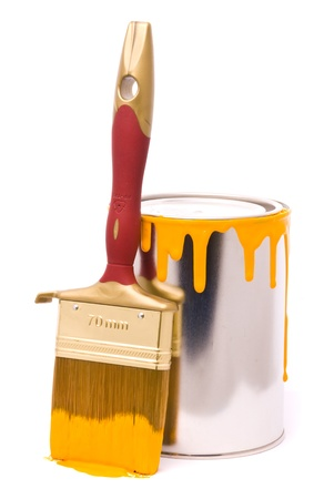 Can of yellow paint and professional brush on a white photo