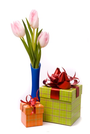 Pink tulips ang gift boxes on a white background photo