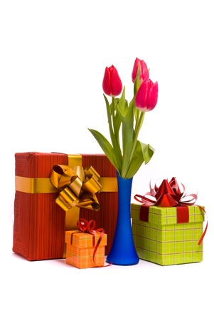 Red tulips in blue vase and gift box on a white background photo