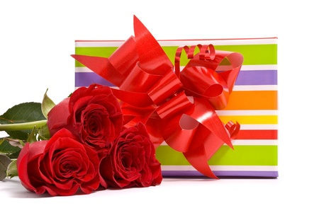 Red roses and gift box on a studio white background photo