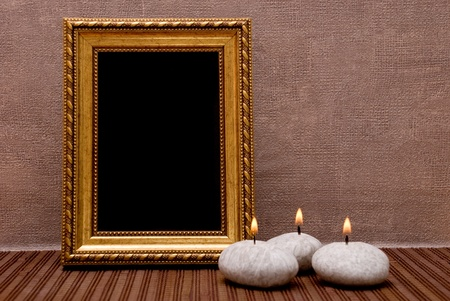 black picture frame: Empty picture frame with candles Stock Photo