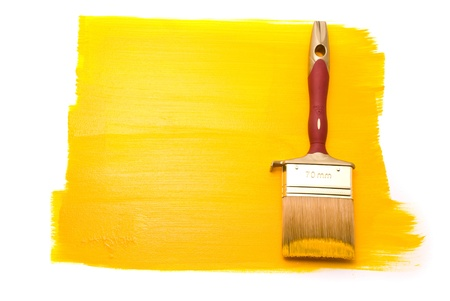Professional brush with yellow paint on the white background photo