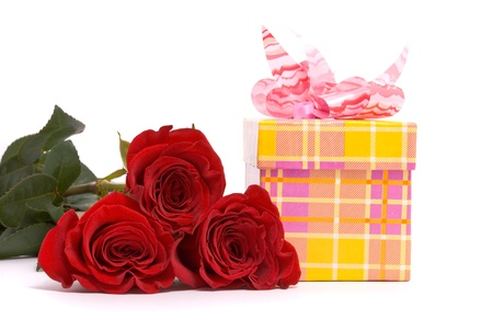 Red roses and gift box on a studio white background. photo