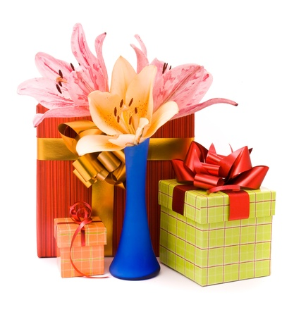 Beautiful lilies and gift boxes on a white background photo